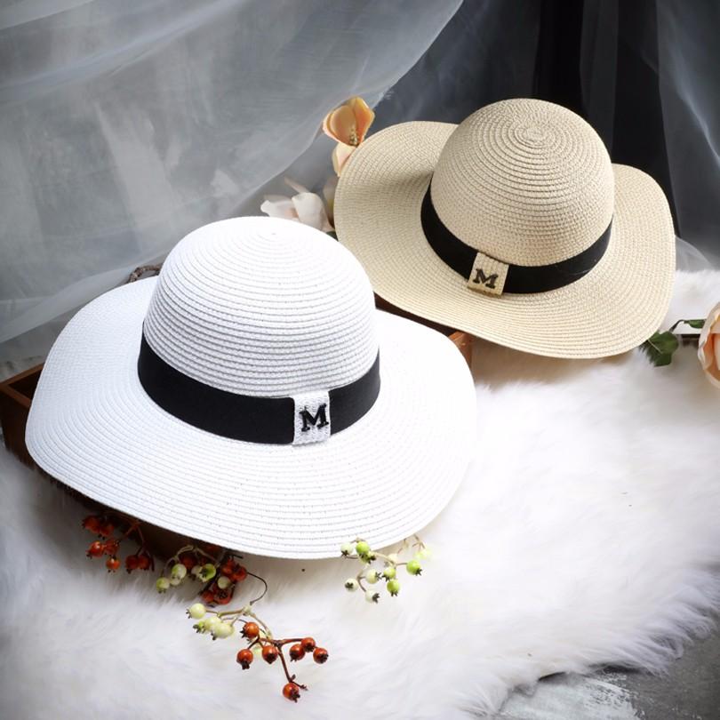 99ce6bb80d652 Hot sale M letter Seaeside sun hats for women summer large brimmed straw hat  folding beach girls sun hat wholesale